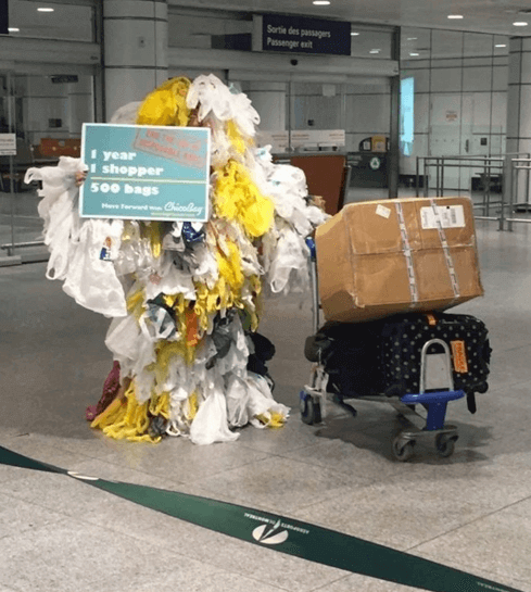 [pic of Rachel dressed as a Bag Monster at Montreal airport to raise awareness on the issue and promote the upcoming documentary screening.]
